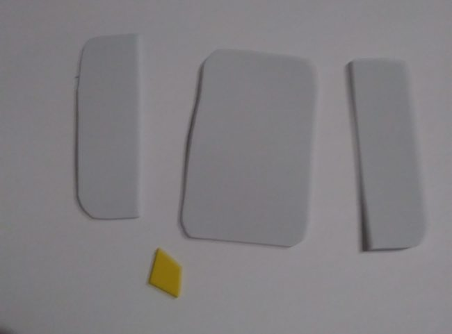 Cut-out pieces of white and yellow foam