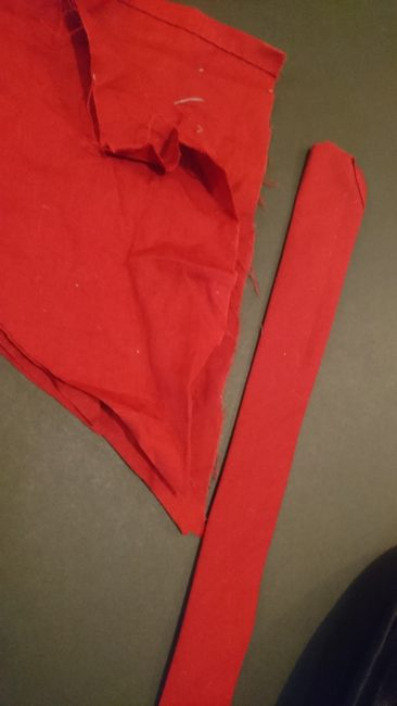 Red fabric plus strip of fabric for project