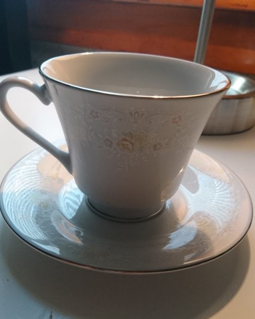 An unpainted tea cup and saucer